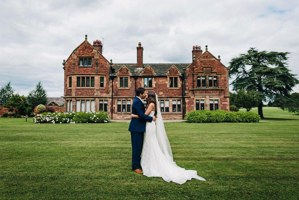 Wedding couple kissing Colshaw hall Cheshire