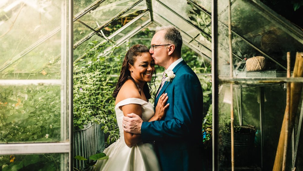 CHESHIRE GARDEN WEDDING PHOTOGRAPHER COUPLE IN GREENHOUSE