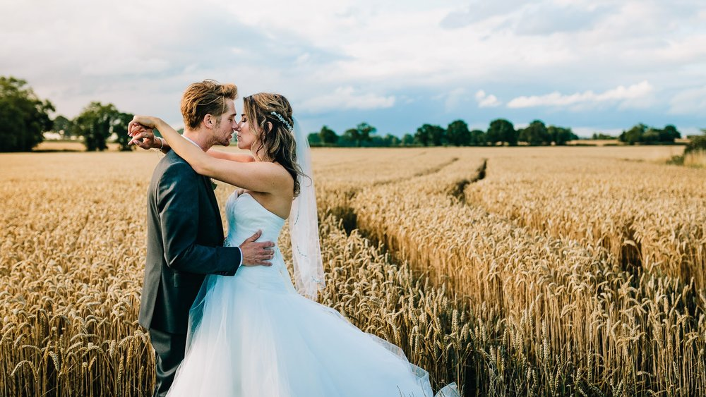 CREATIVE COUPLE PORTRAIT AT MYTHE BARN WEDDING VENUE