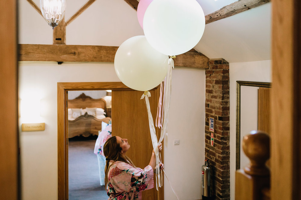 BRIDESMAID HOLDING WEDDING PRETTY BALLOONS
