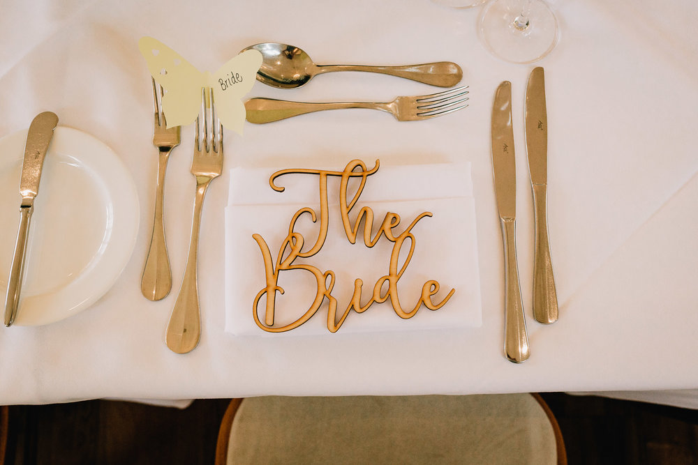 RUSTIC BRIDE PLACE NAME AT WEDDING RECEPTION TABLE