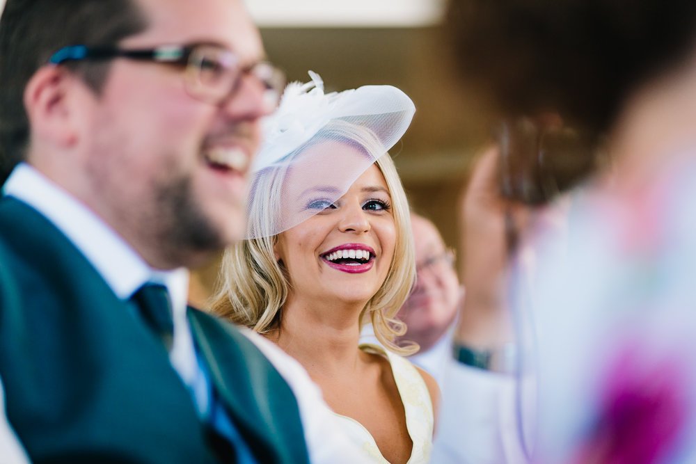 CANDID NATURAL PICTURE OF WEDDING GUEST LAUGHING