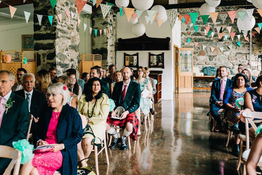 BRIDE ENTERING WEDDING BARN IN SNOWDONIA