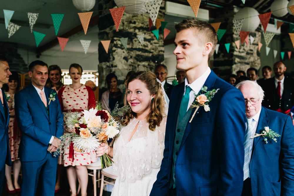 BRIDE AND GROOM GETTING MARRIED IN NORTH WALES BARN WEDDING