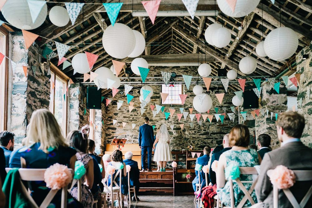 WIDE SHOT OF COUPLE AND GUESTS AT WEDDING IN NORTH WALES