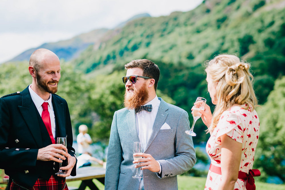 DOCUMENTARY WEDDING PHOTOGRAPH OF GUESTS ENJOYING OUTDOOR RECEPTION IN WALES
