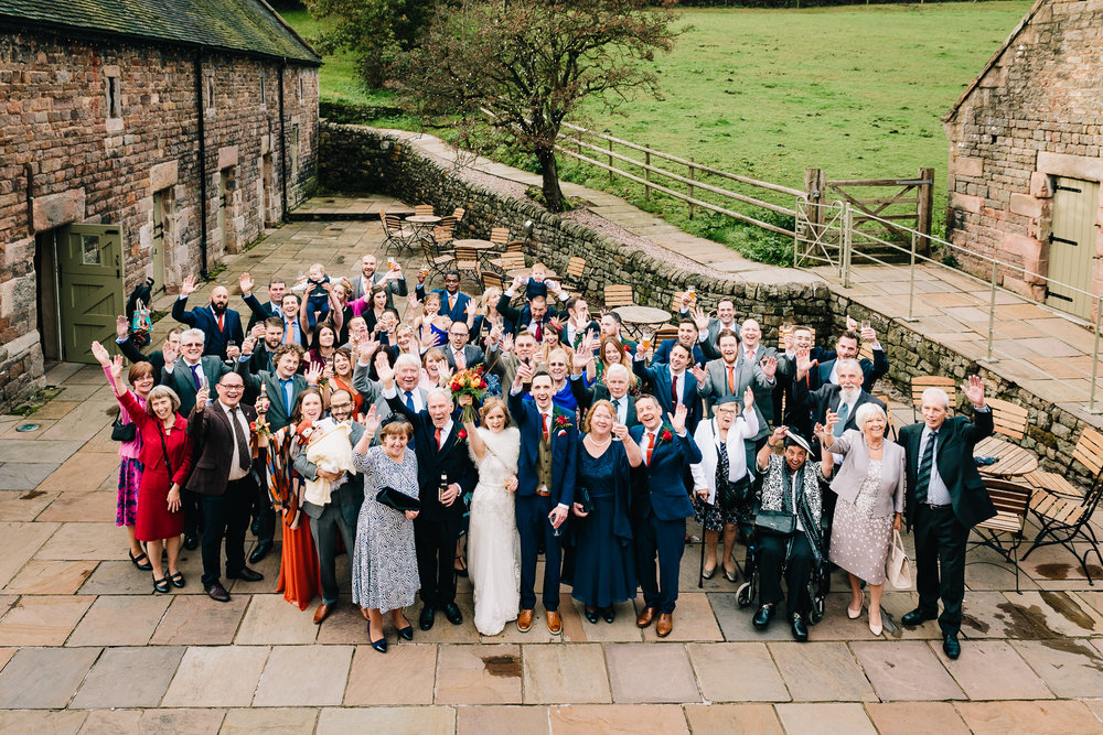 LARGE GROUP WEDDING PHOTO OUTSIDE AT THE ASHES