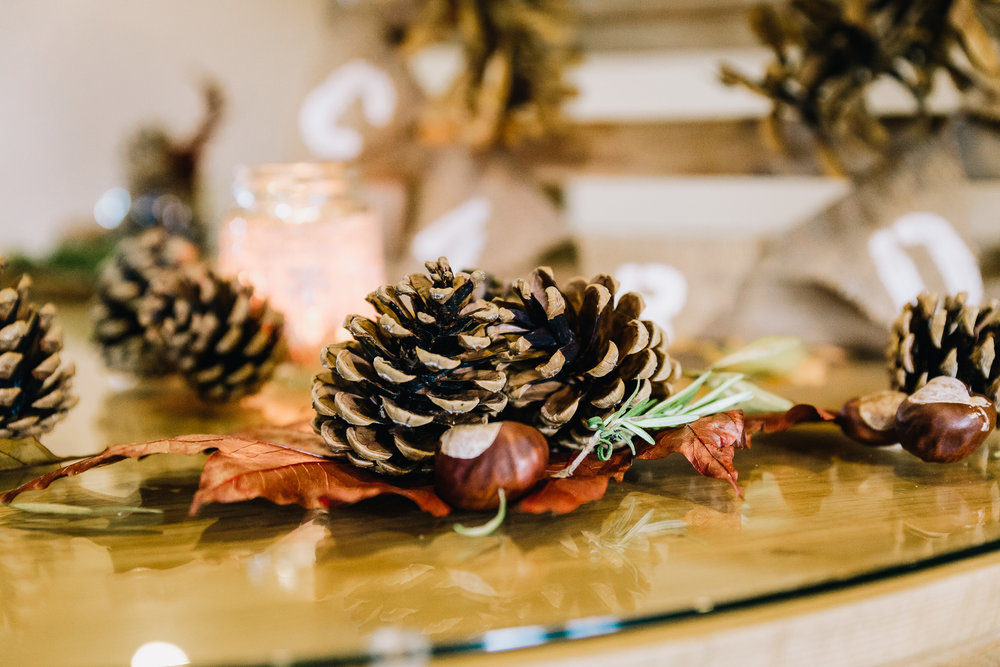 PINE CONES AND PUMPKINS AT WEDDING RECEPTION