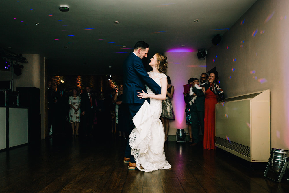 WEDDING COUPLE FIRST DANCE AT EVENING RECEPTION