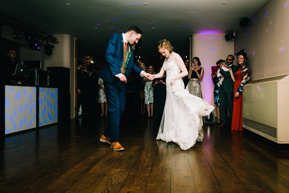 LIZ AND JONNY DANCING AT THE ASHES BARNS