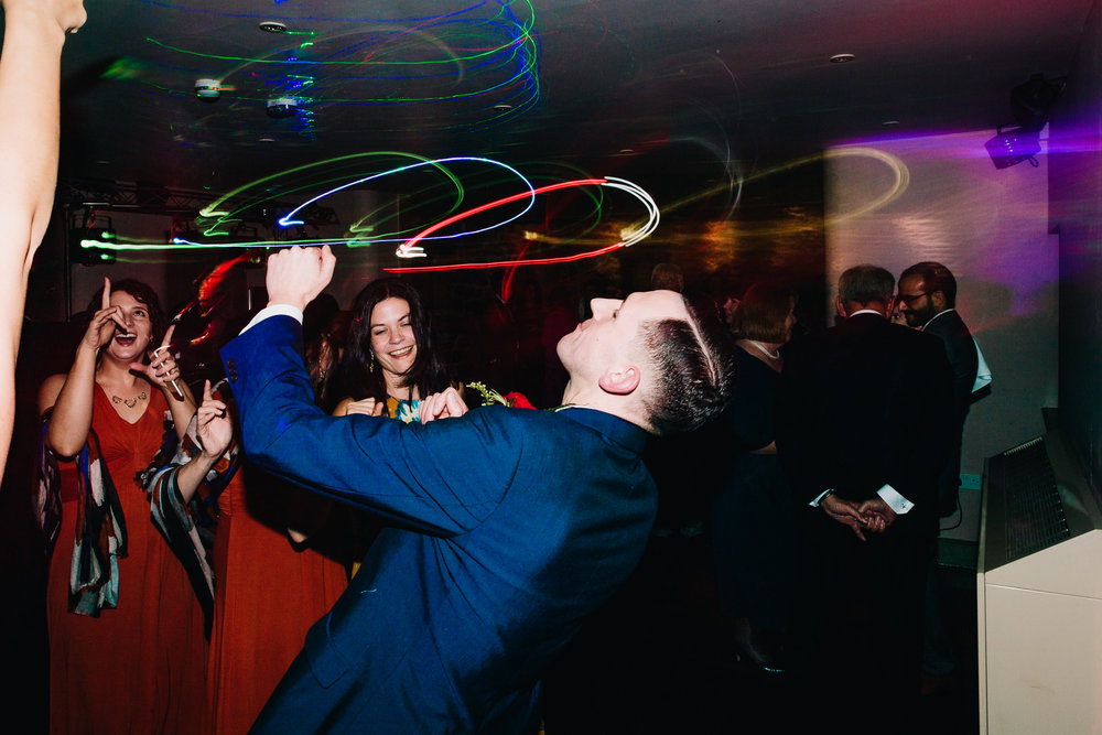 GROOM RAVING AT WEDDING DANCE