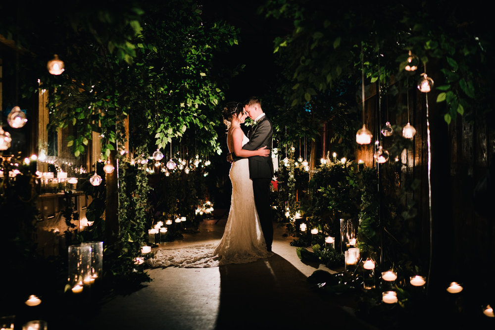 creative night portrait of couple shot at own house wedding barn with flowers by red floral architecture