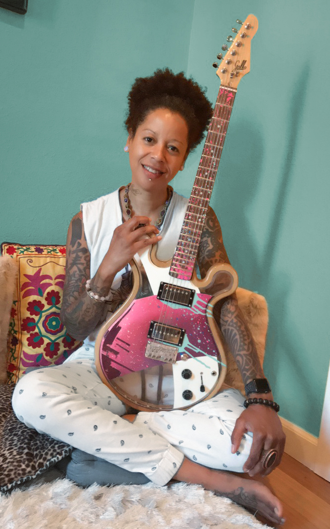 "Bibi McGill at her Portland studio with ""Aurora"", a Gallo Artist Signature Guitar."