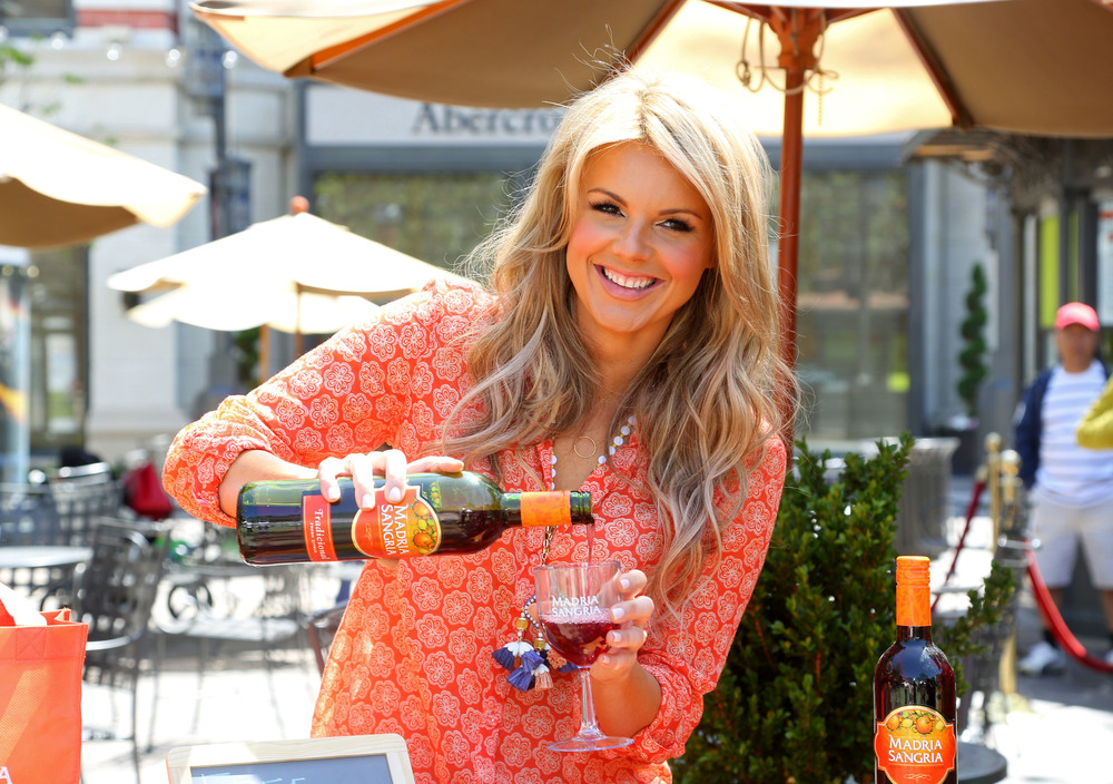 Ali-Fedotowsky-gears-up-for-Cinco-de-Mayo-at-the-Madria-Sangria-Fruit-Stand-April-26-The-Grove-Los-Angeles-pouring-2.jpg