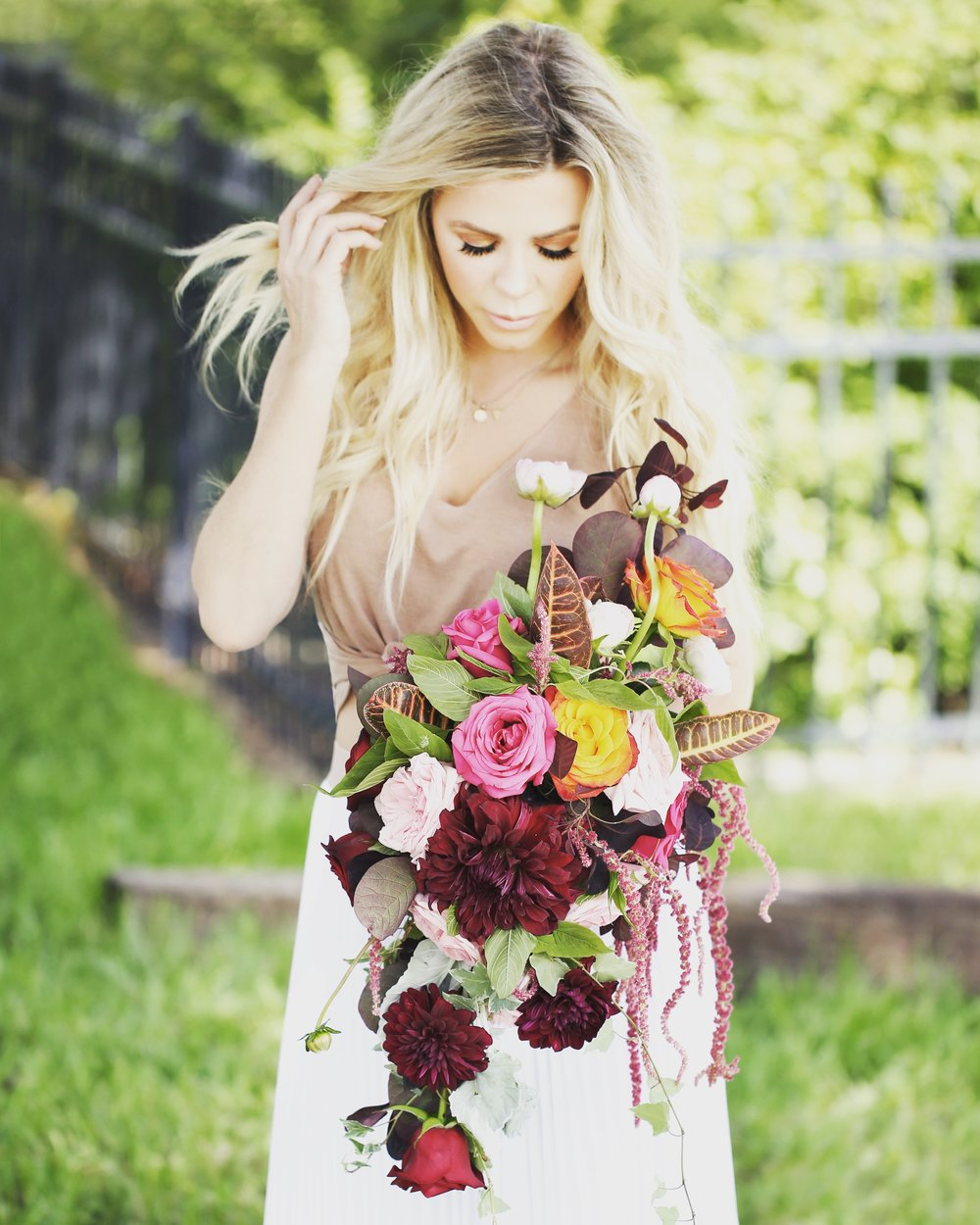 Dahlias, garden roses, spray roses, ranunculus, hanging amaranthus