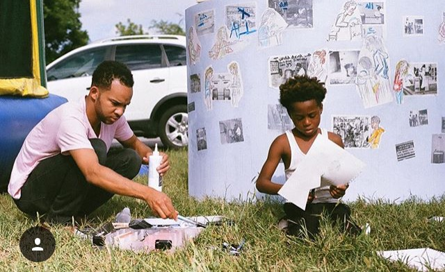 "Josiah works with a young budding artist on the Welcome Well at the ""Gospel on Glass"" music festival on September 27, 2015. Photo by Ashton Lance."