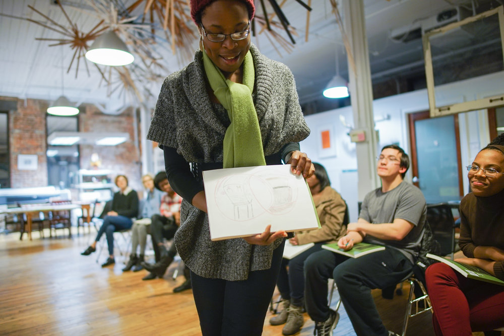 "Ogechi shares her drawing and its meaning during our 800 Session, ""The Art of Free Space,"" in Atlanta, GA. Photo by LeAndra LeSeur"