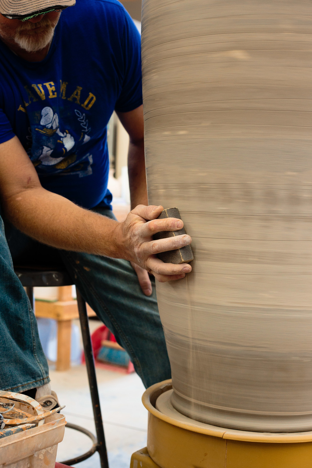 Potter working at pottery wheel