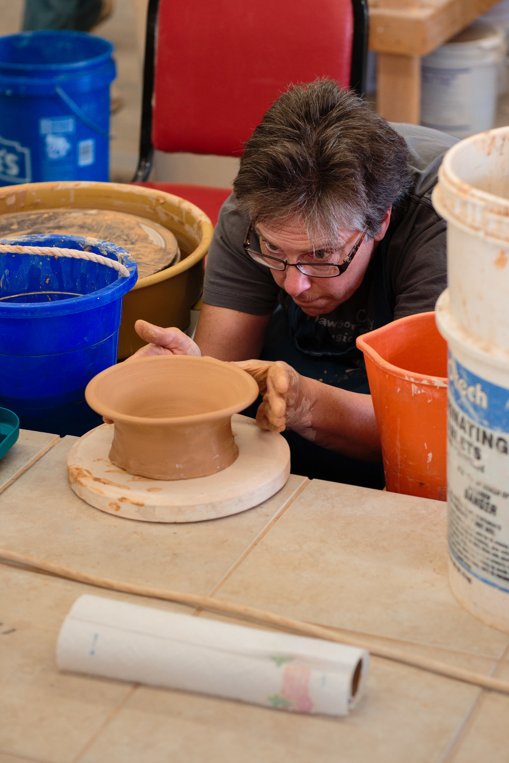 Artist inspects pottery work