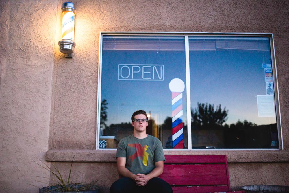 Barber shop front musician portrait