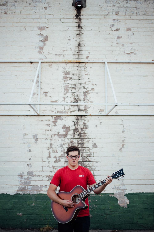 Urban portrait artist playing guitar Hurricane Utah