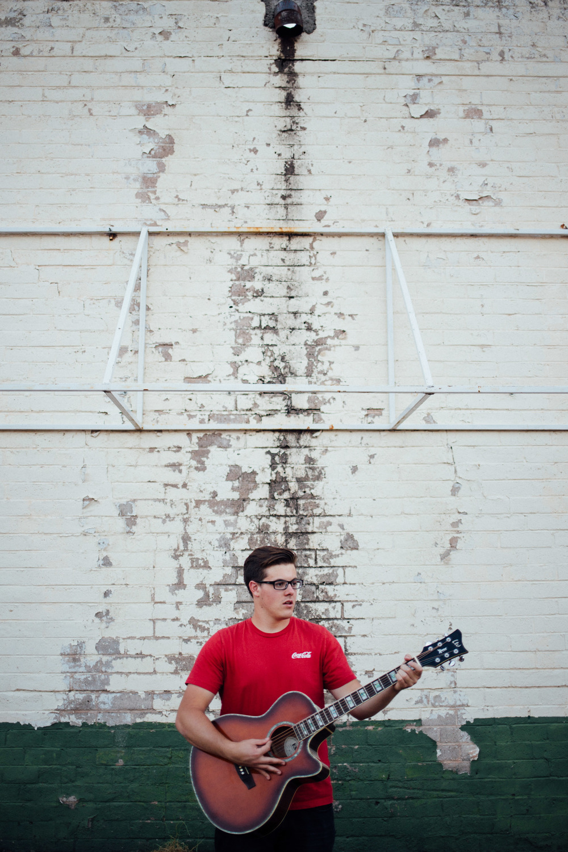 Singer-songwriter playing guitar Utah musician photographer