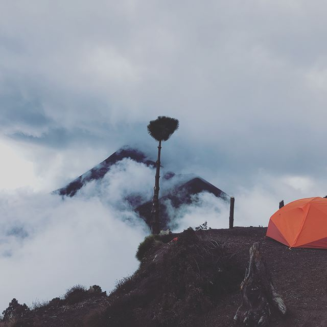 Our campsite in the clouds on #Acatenango overlooking #volcanfuego for the night. Fuego has periodic small blasts throughout the day with larger ones usually happening around 2am. We spent the night here before summiting Volcán Acatenango 4000 meters up for a better and much colder viewing spot.
