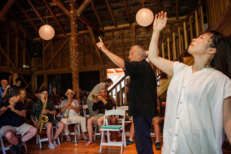 Karl Berger, second from right, conducting a Creative Music Studio session at the Full Moon Resort while Michiru Inoue dances. CreditLauren Lancaster for The New York Times