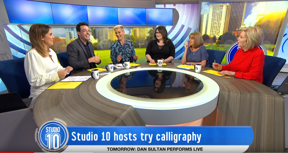 studio 10 hosts try calligraphy.PNG