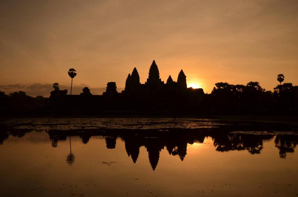 A photo taken during my trip to Cambodia in 2013. Watching the sunrise over the Angkor Wat  temple.