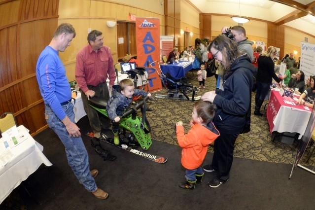 Don Hickman and Jim Bradley, ADAPT sports, demonstrate a ski chair to Sara Clippinger and children during the Special Needs Summit March 15, 2018, at Hill Air Force Base, Utah. The annual summit gives the base community a chance to research and learn about many speacial needs services and opportunities available in the area. (U.S. Air Force photo by Todd Cromar)