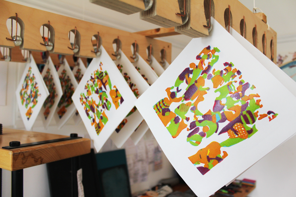Prints drying in the racks after their forth print