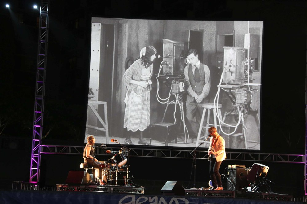 Magnetix playing a live soundtrack to the Buster Keaton silent film,  Cops .