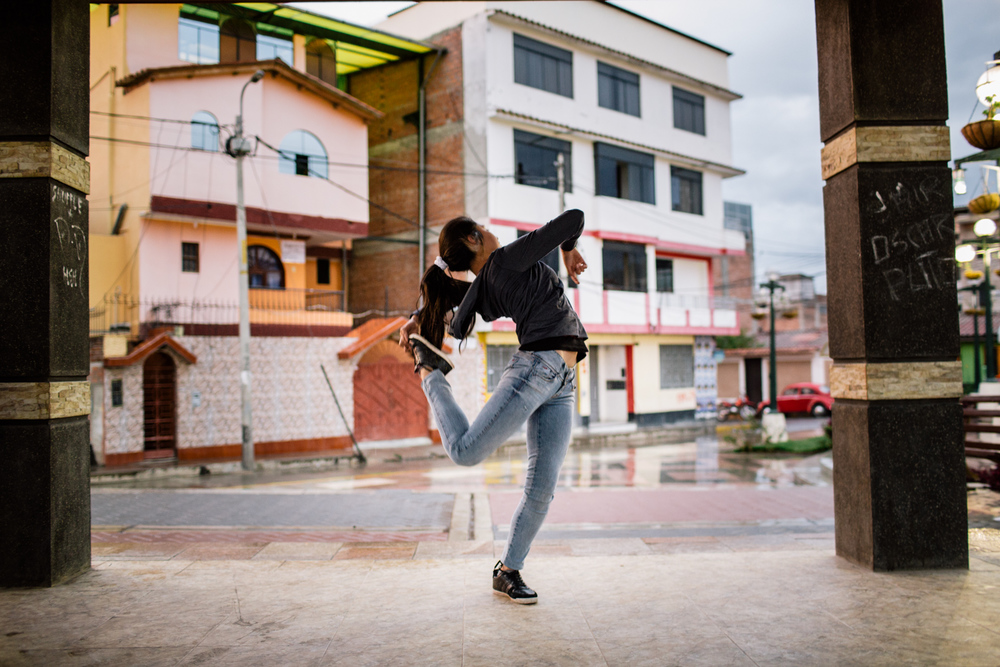 Yasmin Padilla, student and break-dancer in the Urban Style Crew is training in Parque Fap.     The young generation of Huaraz is much more conscious of it's impact on the environment and how to interact with it. If their parents were mostly attracted by mining opportunities, many young now train to become mountain guides or work in the touristic field.