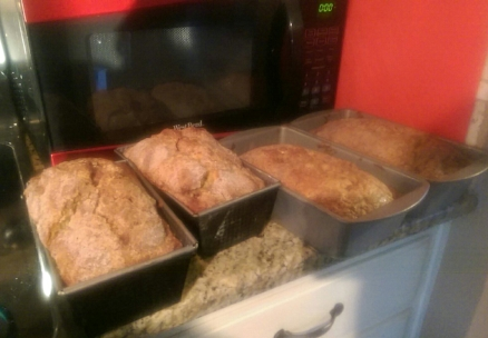 Four loaves of homemade banana bread, fresh from the oven.