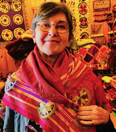 Yildiz Yagci, Founder and director of Anatolian Artisans, modeling a vintage Oya shawl