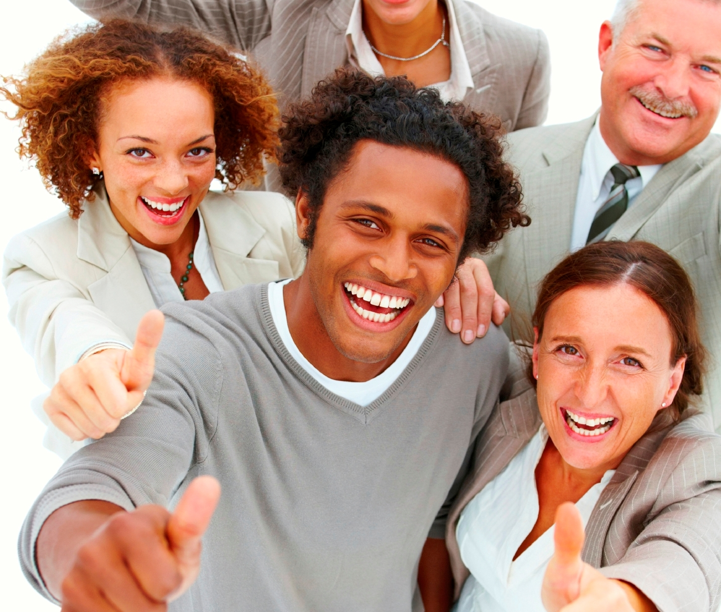 Portrait of happy business people with thumbs up against white background