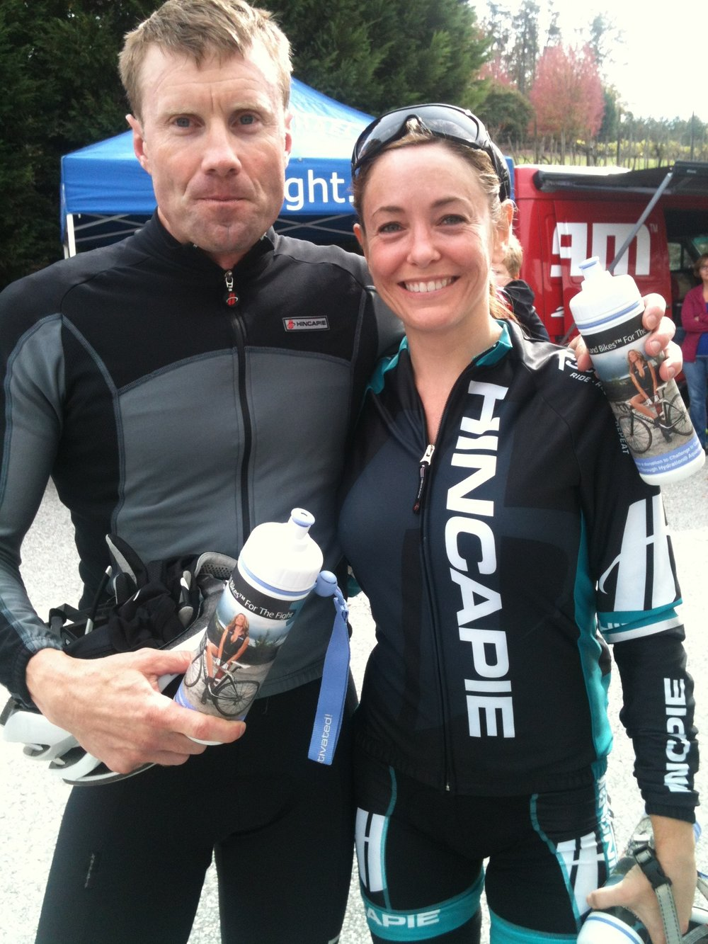 hincapie couple with bottles.JPG