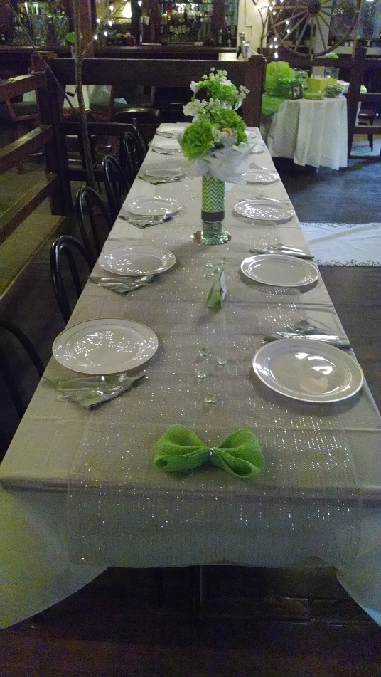 white table setting, green flowers.jpg