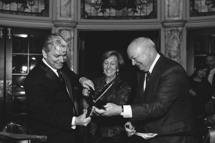 Tom Quaintance, Vice Mayor Dr. Theresa Whibley, and Paul Fraim, former mayor and current President of the Slover Library Foundation, cutting the ribbon for the Grand Reopening. Photo by Rico Marcelo
