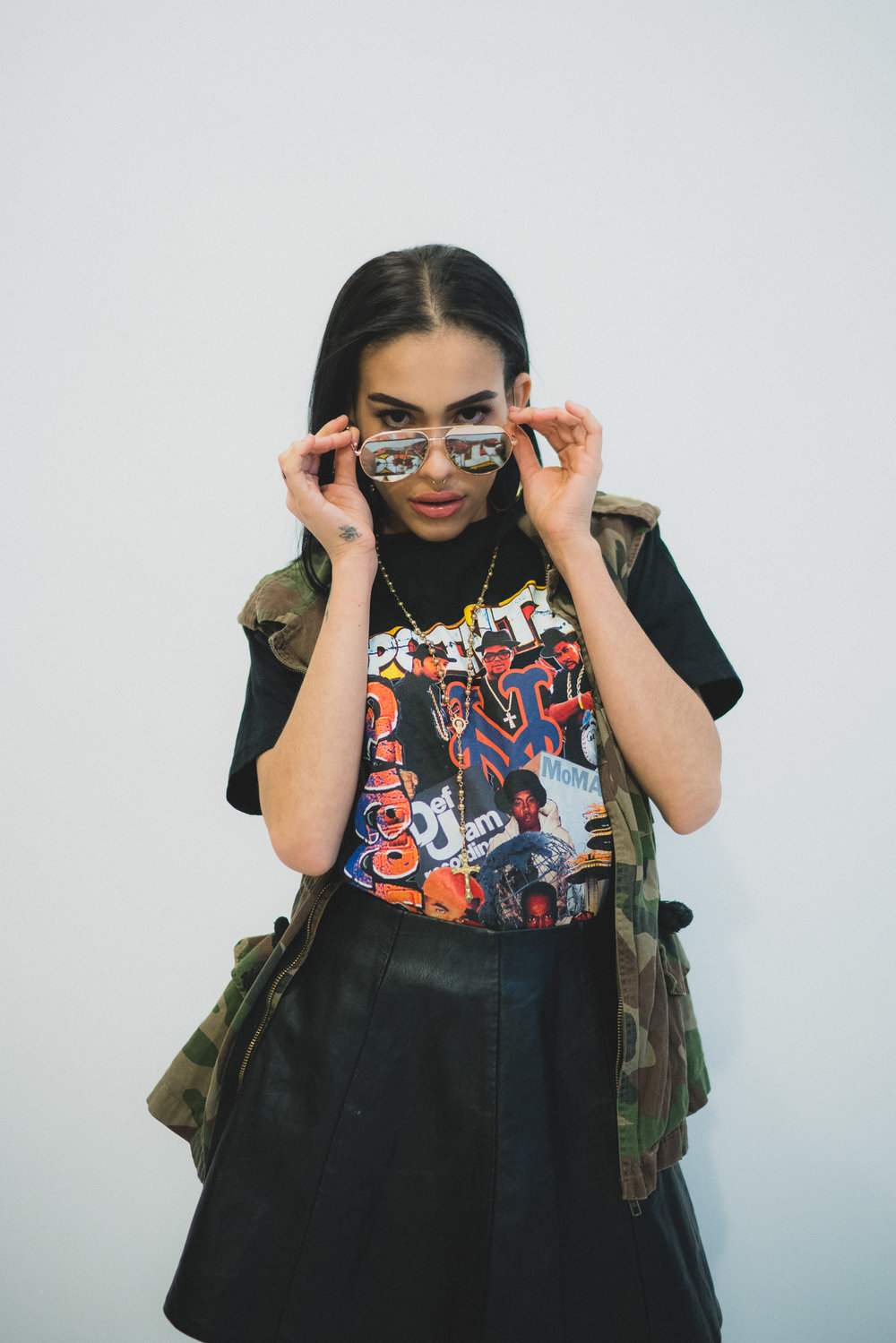 Model in BaskxQueens shirt