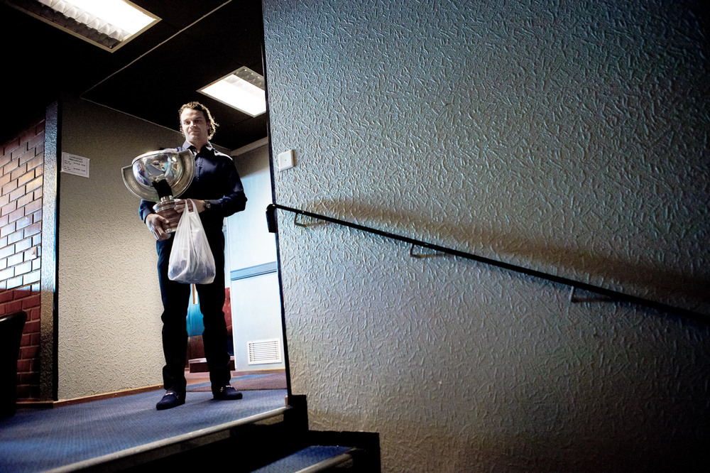 Janne Pesonen holds the ice hockey world champion trophy. Medal and the game jersey are in the plastic bag.  © Kainuun Sanomat