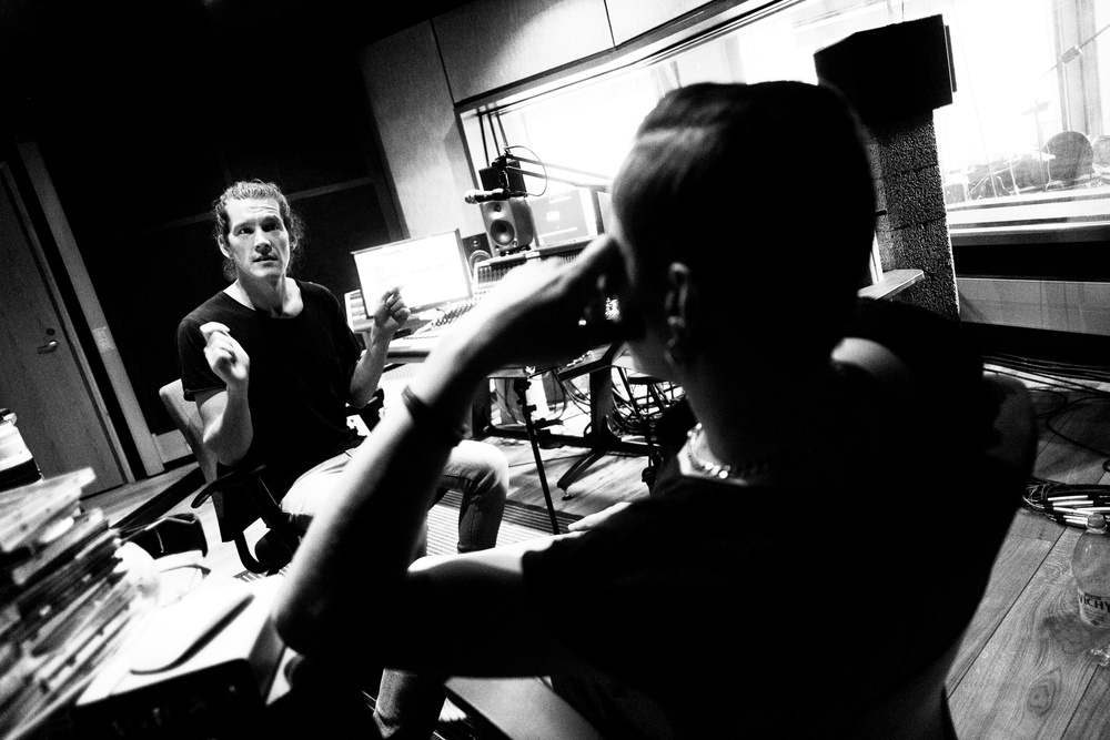 Producer Arto Tuunela showing drumming moves to CMX drummer Olli-Matti Wahlström.