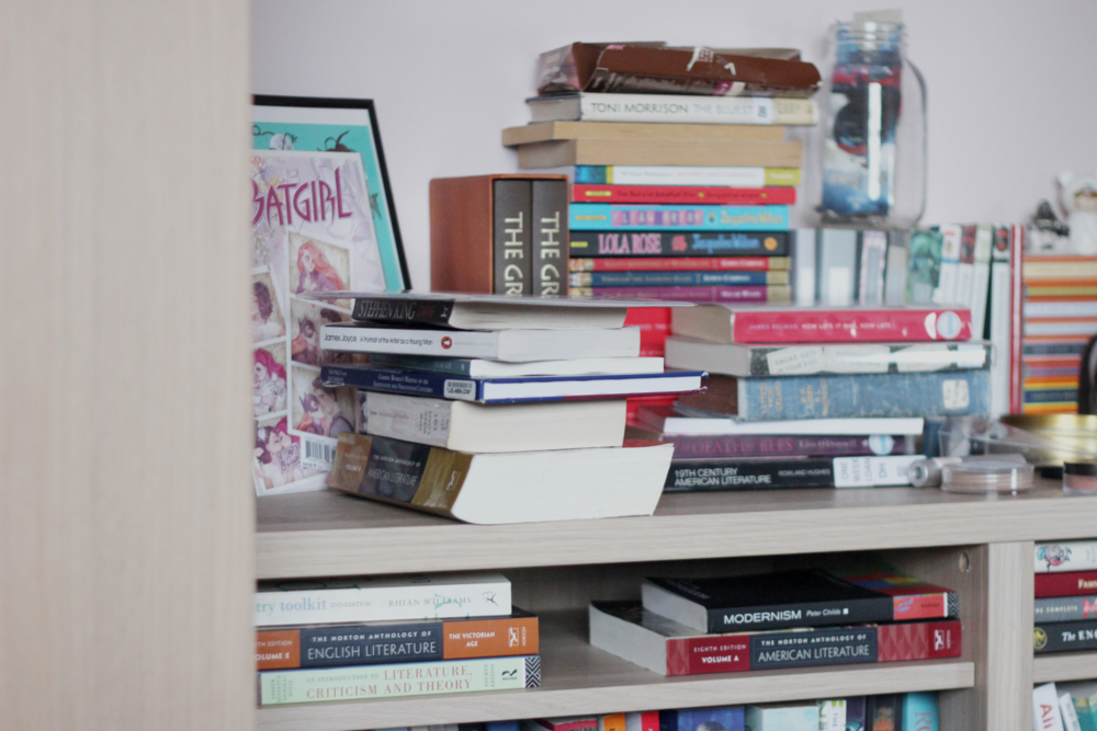 (Here's a sneak peek of my ridiculously messy bookshelf...)