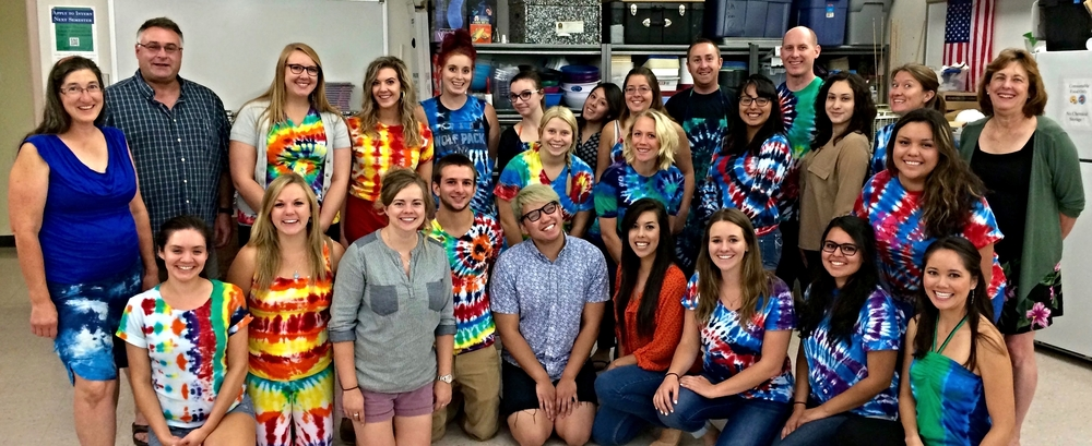 July 24, 2015 :  Last day of class:  NNELI participants stopped from giving final presentations to take a class picture.  Most of the pre-service teachers and classroom teachers were dressed in their own tie dye creations that were made in Professor David Crowther's science lab.  The photo also marked the end of the NNELI specialized summer courses in STEM and academic language, a three-week intensive professional development workshop available only to NNELI grant participants.