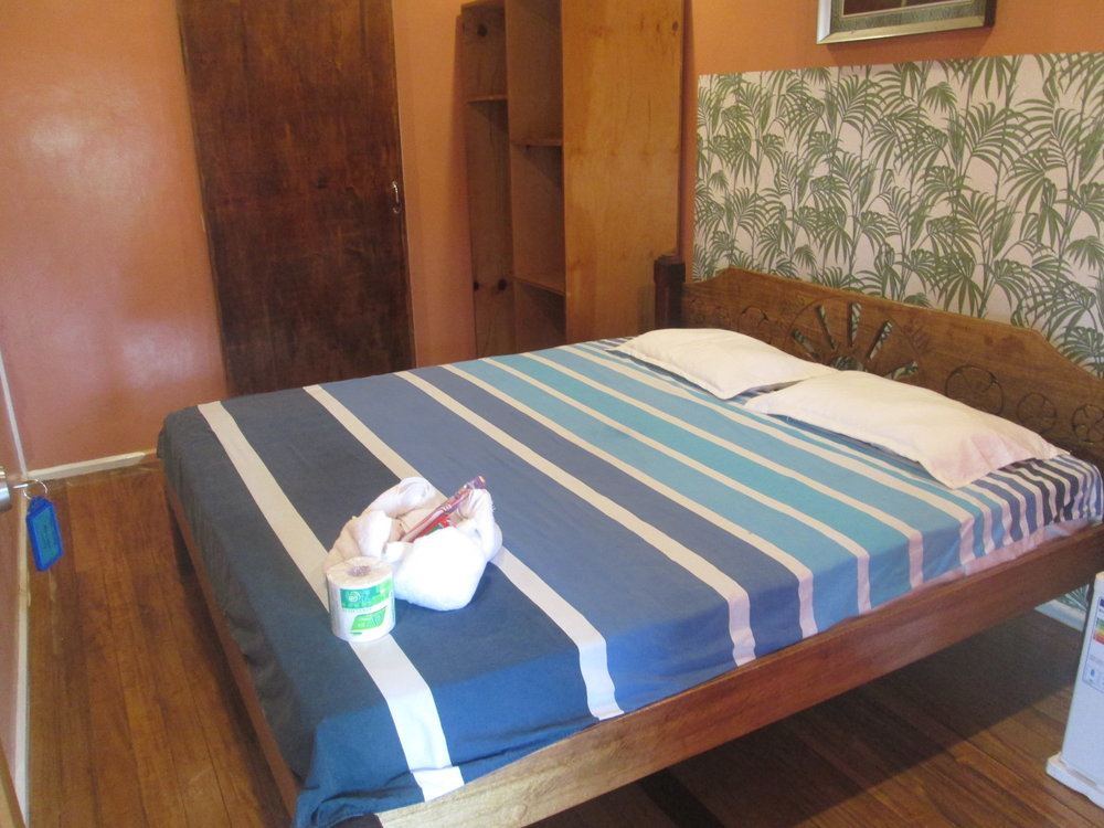 Rising Sun Lodge Room Bed1.JPG