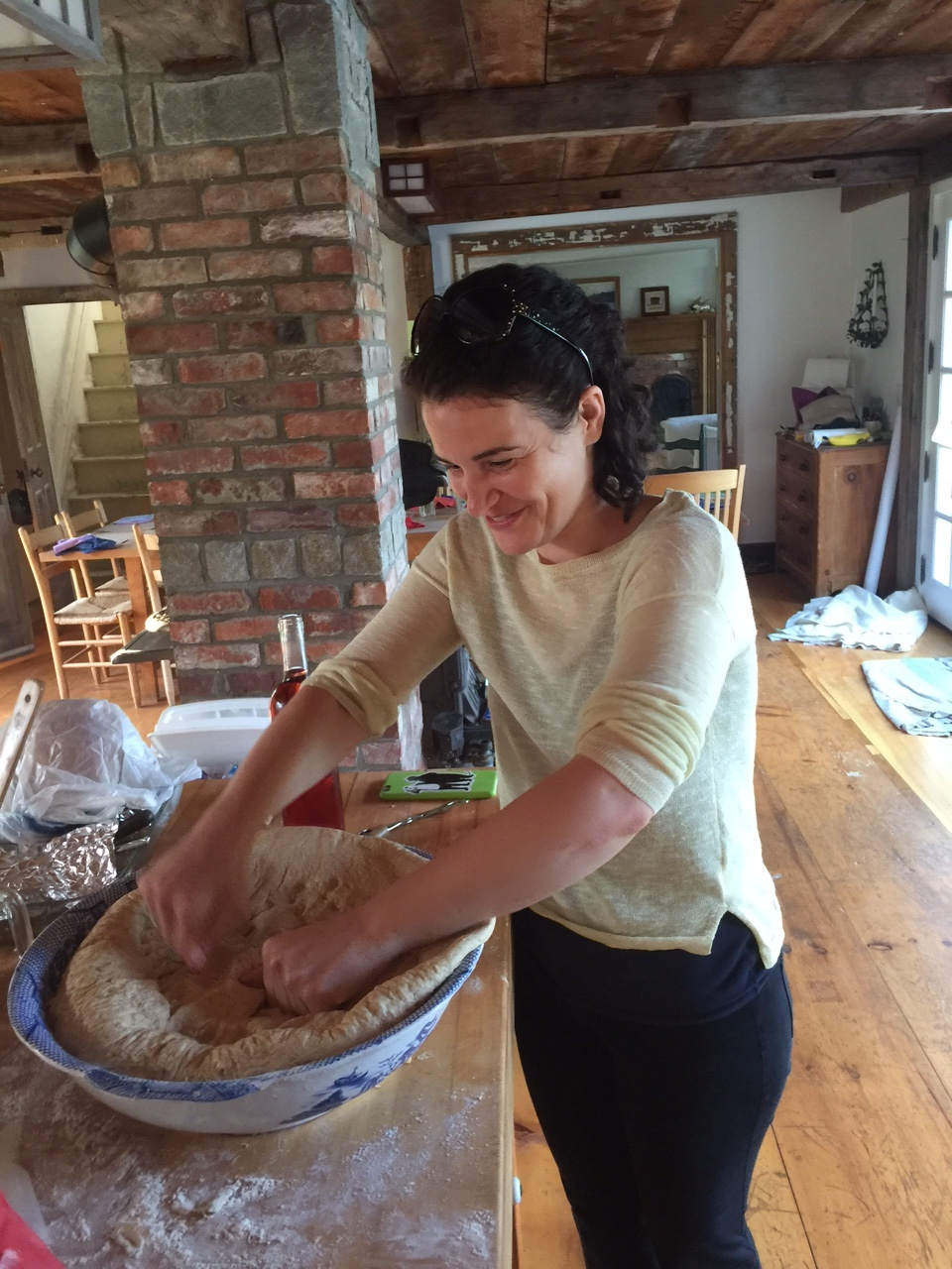 Punching bread at the Poor Farm.  Photo by Charles Melcher.