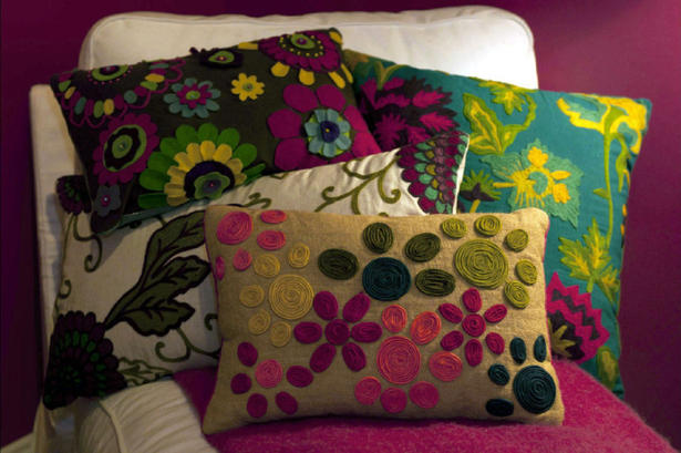 "This Sept. 23, 2010 photo provided by Meg Volk shows decorative pillows on display at a Homegoods event showcasing designer Elaine Griffin's ideas on how to create a Mom cave. Griffin says, ""A Mom Cave is where the woman who nurtures everyone goes to nurture herself."" (AP Photo/Meg Volk) NO SALES"