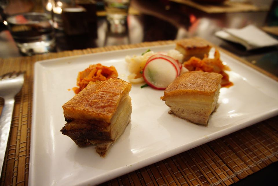 Crispy skin pork belly served with kimchee and lychee radish salad with mint