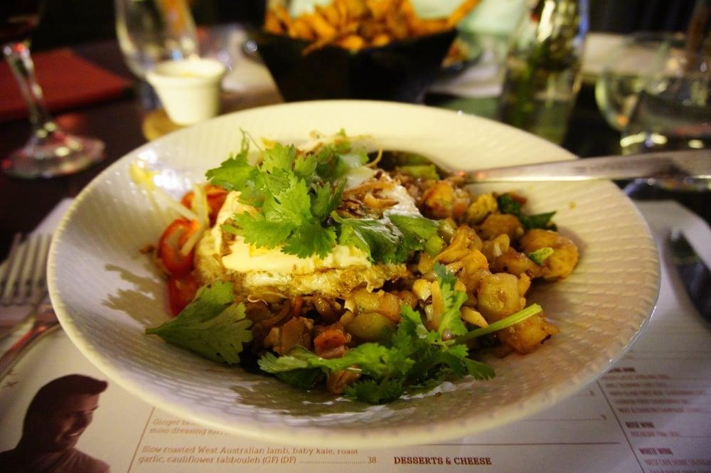 Nasi goreng with chicken, pancetta, prawns, cauliflower rice and free range hens egg (GF)